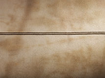 Brown leather with seam. For background stock photography