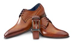 Brown leather shoes with belt and clipping path Stock Photos