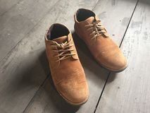 Brown leather shoes on the floor Royalty Free Stock Photos