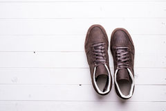 Brown leather shoes with laces on wooden background. With empty text space Royalty Free Stock Photos