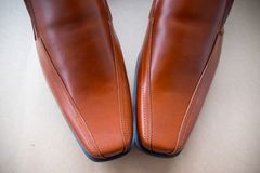 Brown leather shoes. Stylish brown male shoes, top view Royalty Free Stock Photo