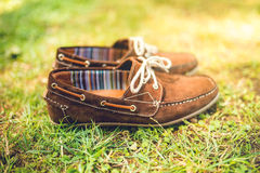 Brown leather shoes, suede leather. mens fashion concept, brown mocassins ready for catalog and sale Royalty Free Stock Photo