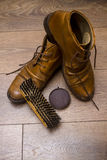 Brown leather shoes on a wooden floor Royalty Free Stock Photo