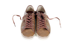 Brown leather sneakers isolated Royalty Free Stock Images
