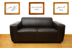 Brown leather sofa and blank photo frames Stock Photo