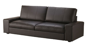 Brown leather sofa Stock Images