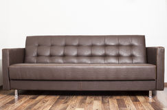 Brown leather sofa in room. Isolated Royalty Free Stock Images