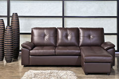 Brown leather sofa with stool Stock Photos