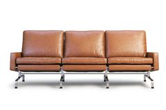 Brown leather sofa. Three-seat sofa 3d render. Brown leather sofa with chrome base. Modern sofa. Sofa for office. Three-seat sofa. Realistic folds. 3d model Royalty Free Stock Image