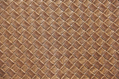 Brown leather square woven weaved pattern close up. Brown leather square woven weaved pattern used for upholstery Stock Photo