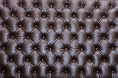 Brown leather texture - background. Brown leather texture of sofa closeup shot Royalty Free Stock Photo