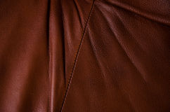 Brown leather texture with folds. And seam Royalty Free Stock Photography