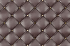 Brown Leather Upholstery Sofa Background. Brown Luxury Decoration Sofa. Elegant Brown Leather Texture With Buttons For. Pattern and Background. Leather Texture Stock Photo