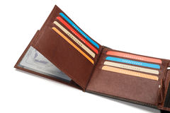 Brown Leather Wallet Card Compartments. Layers of credit card compartments of an opened brown leather wallet Royalty Free Stock Image