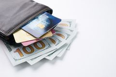 Brown leather wallet with credit, debit, discount cards and dollars Stock Photography