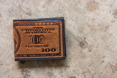 Brown leather wallet. Doeskin on the old cement floor Stock Photography