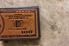 Brown leather wallet. Doeskin on the old cement floor Stock Photo