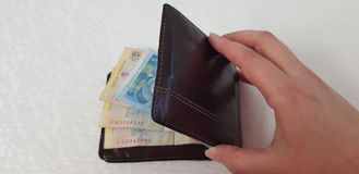 Brown leather wallet full of various hryvnia banknotes royalty free stock image