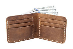 Brown leather wallet with money isolated on white Royalty Free Stock Photos