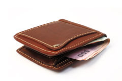 Brown leather wallet  with money isolated on white Royalty Free Stock Photography
