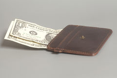 Brown Leather Wallet With One Dollars On Gray Stock Photo