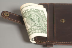 Brown Leather Wallet With One Dollars On Gray Royalty Free Stock Images