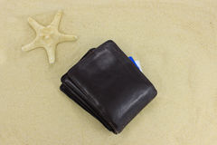Brown leather Wallet on sand Stock Images