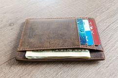 Brown Leather Wallet and Us Dollar Banknote Stock Images