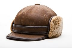 Brown leather winter hat wool texture studio. Quality white background royalty free stock image