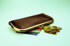 Brown leather women`s purse next to which colored discount cards Stock Image