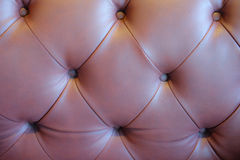 Brown leathered sofa Stock Images