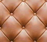 Brown Leathered Sofa with Buttons Texture Seamless Background Stock Image