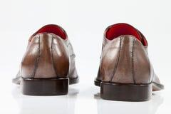 Brown-lederne Schuhe Stockfoto