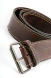 Brown-lederner Gurt mit Metallc$gurtschnalle Stockbild