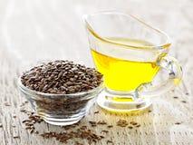 Brown-Leinsamen und Leinöl stockbilder