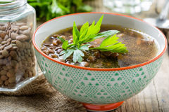 Brown lentil soup with mushrooms in bowl Royalty Free Stock Photography