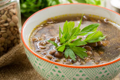 Brown lentil soup with mushrooms in bowl Stock Photo