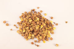 Brown lentils. A lot of brown lentils, on white isolated background Royalty Free Stock Photography