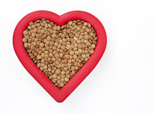 Brown Lentils in Red Heart Stock Images