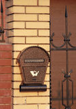 Brown letterbox on the fence Royalty Free Stock Photos