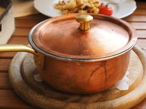 Brown Lidded Cooking Pot on Gray Round Wooden Coaster Royalty Free Stock Images