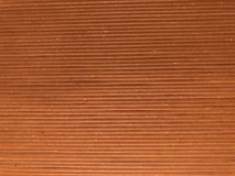 Brown and light brown wooden panel looking board, background, texture. Brown and light brown transversely furnished wooden panel looking board, background Royalty Free Stock Images