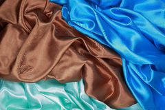 Brown and light green and blue Silk cloth of wavy abstract backg Royalty Free Stock Photos