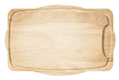 Brown light wooden cutting board. Royalty Free Stock Photo