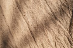 Brown linen canvas. The background image, creases texture background royalty free stock photography