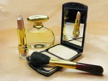 Brown lipstick powder and perfume bottle Royalty Free Stock Image