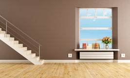 Brown living room with staircase Royalty Free Stock Images