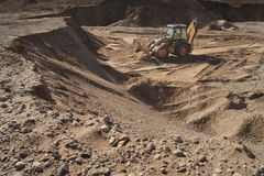 Brown loader in the quarry. Work on brown bulldozer, loader, excavator in quarry Stock Image