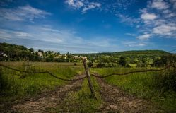 Brown Log Fence Stand during Daytime Royalty Free Stock Images