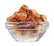 Brown lump cane sugar heap in glass bowl Stock Photos